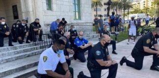 policias se arrodillan Oklahoma